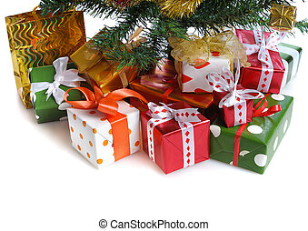 red gift boxes under Christmas tree - heap of red gift boxes...