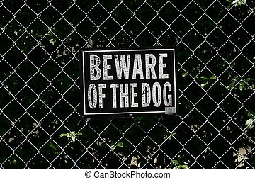 Beware of the Dog - A sign warning readers to beware of the...