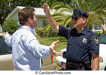 Field Sobriety Test - Police officer giving a field sobriety...