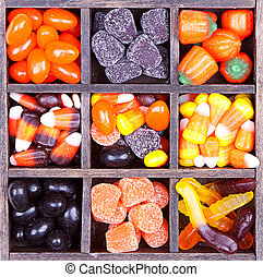 Halloween candy arranged in a printers box, assorted...