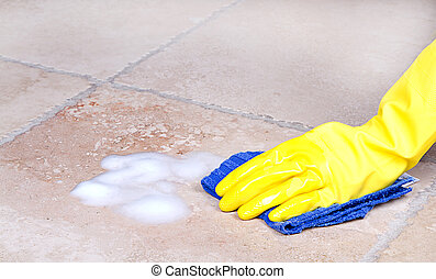 cleaning tile with cloth - gloved hand cleaning tile with...