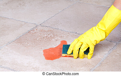 Cleaning up spill with sponge - Cleaning up juice spill on...
