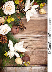 Christmas flowers and pine branches on wooden background