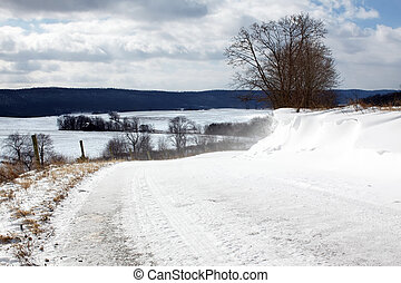 Snow Covered Road - Snow blowing over a rural Pennsylvania...