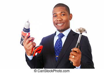 Handy businessman holding hammer and drill