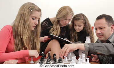 Playing chess - Father playing chess with his daughter