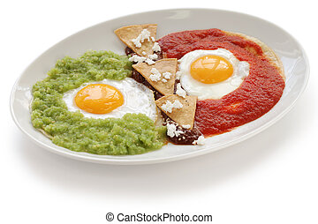 huevos divorciados, mexican cuisine - fried eggs on corn...