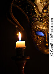 Venetian Mask - Lighting candle against beautiful classical...