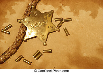 Sheriff In Town - A sheriff badge and gun shells on some...