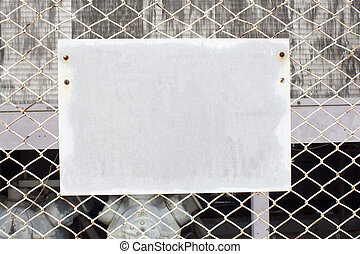 blank sign on chain link fence