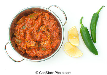 Curry dish - Hot chicken jalfrezi in a curry dish with lemon...