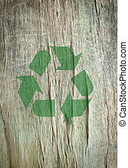 Recycle symbol printed on a tree