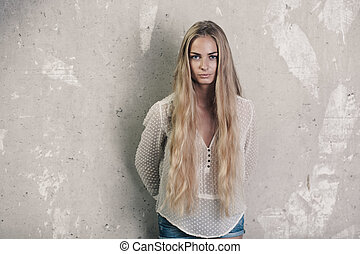 Longhaired blond girl - Longhaired girl over grunge wall