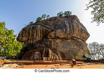 Lion gate entrance facade of Sigiriya rock fortress and...