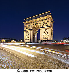 Arc de Triomphe by night with car lights