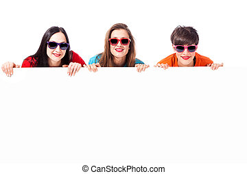 Three attractive girls with board - photo of three...