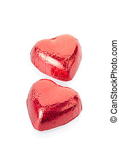 Red chocolate hearts on white - Red chocolate hearts...
