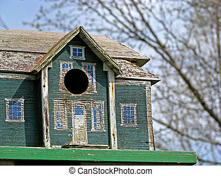 old birdhouse - close-up photo of old backyard weathered...