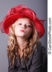 Fashion girl  - Portrait of beautiful girl in red hat