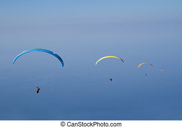 Para gliding - para gliders isolated against blue