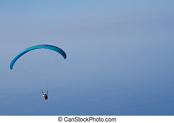 Para gliding - para glider isolated against blue