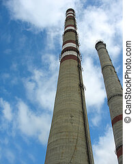 Two chimneys on the cloudy sky - Two chimneys of power plant...