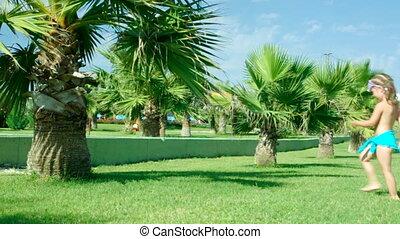 Little girl on palm-treesantalya, - Little girl on...