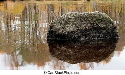 boulder in the water