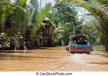 Boat - brown mekong river and tourist boat in Vietnam