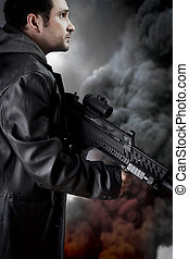 Man with long leather jacket and assault rifle, black smoke...