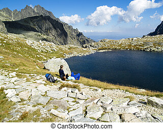 Couple on the lake - Couple of turist siting on the mountain...