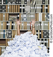 Buried Businesswoman - Buried in papers at the office