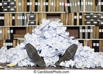 Buried Businessman - Buried in papers at the office