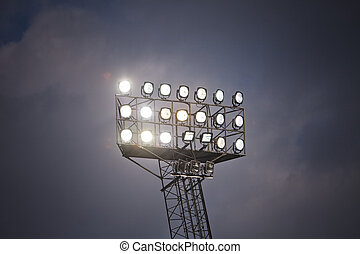 Stadium Lights in front of cloudy sky