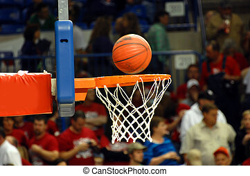 In the Basket - Crowded gymnasium watches a spinning...