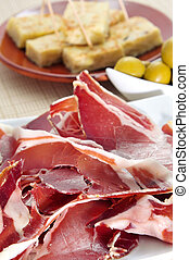 spanish tapas - some spanish tapas, as serrano ham, olives...