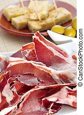 spanish tapas - some spanish tapas, as serrano ham, olives...