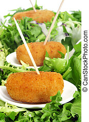 spanish croquettes - closeup of some bowls with spanish...