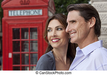 Man and Woman Couple In London With Red Telephone Box - A...