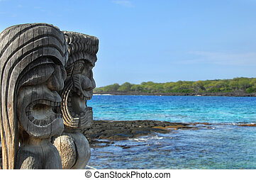 Hawaiian Culture - Two wooden hawaiian carvings look out...
