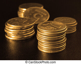 golden coins stacks - golden toned some coins stacks on...