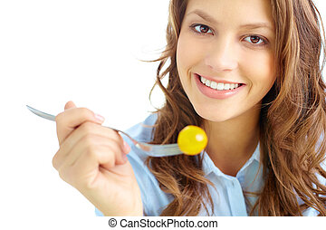 Low calorie diet - Close-up of pretty girl holding fork with...