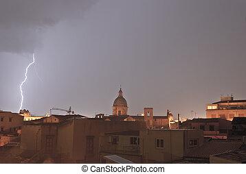 lightning over urban houses in Palermo - lightning over...