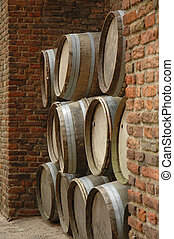 Stacked oak barrels - Pile of old wooden barrels by a...