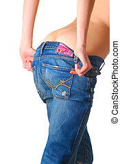 Girl putting down jeans (isolated on white background)...