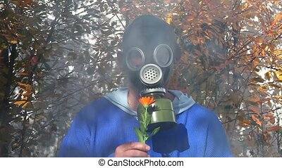 gas mask - Smoke rising behind a man in a gas mask