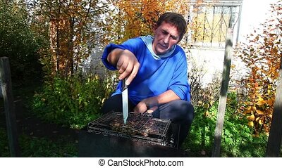 Barbecue - Senior man cooking barbecue meat on the grill