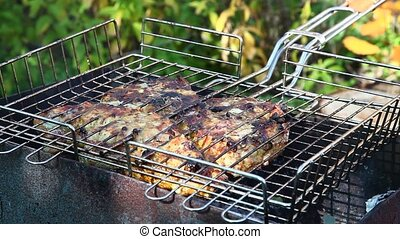 Steaks Flipped on Grill - Sirloin beef steak being cooked on...