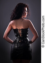 desired brunette woman posing in leather corset - Slim sexy...