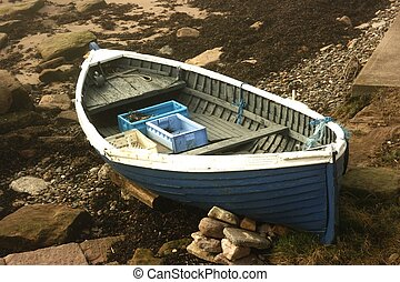 Beached rowing boat on the shore at Berwick upon Tweed,...